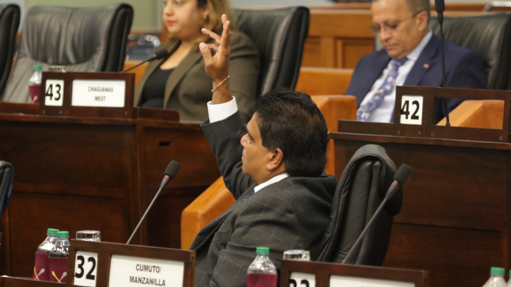 The Member of Parliament for Oropouche East, Dr. Roodal Moonilal, MP, raising his hand to a give a Personal Explanation. © 2019 Office of the Parliament.
