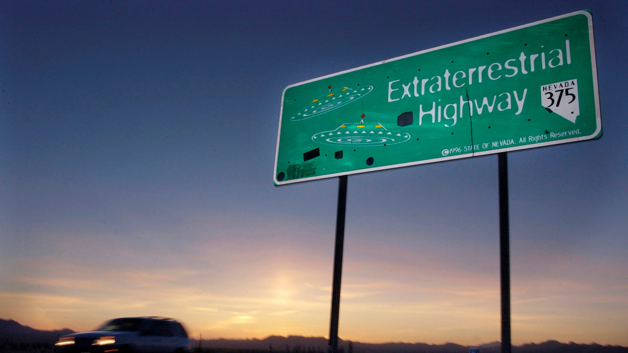 """In this April 10, 2002, file photo, a vehicle moves along the Extraterrestrial Highway near Rachel, Nev., the closest town to Area 51. The U.S. Air Force has warned people against participating in an internet joke suggesting a large crowd of people """"storm Area 51,"""" the top-secret Cold War test site in the Nevada desert. (AP Photo/Laura Rauch, File)"""