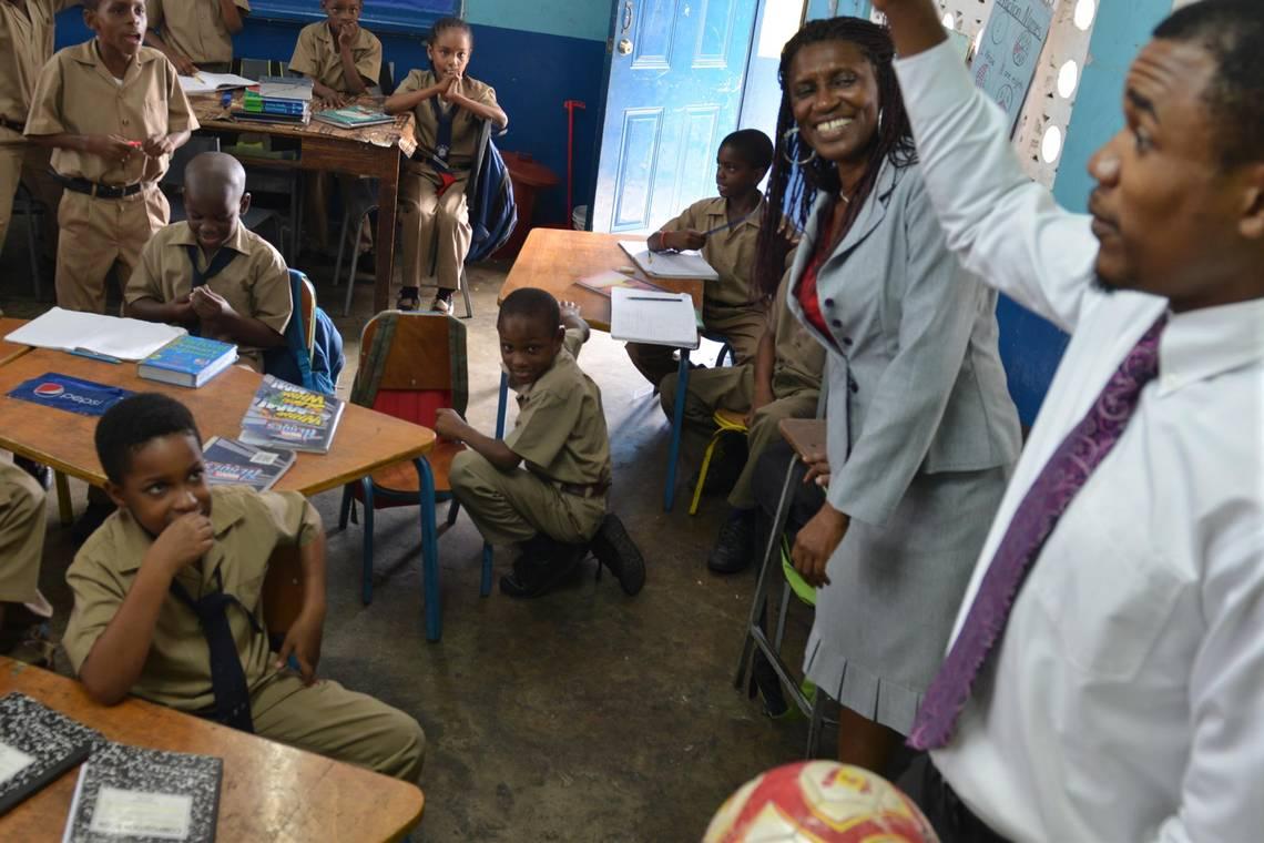 Les enfants de la Jamaïque sont régulièrement exposés à la violence, ce qui affecte plus tard leur comportement./Photo: David McFadden- AP