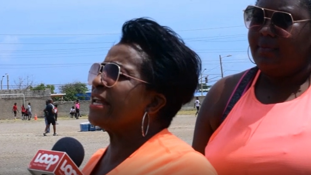 People's National Party (PNP) East Rural St Andrew caretaker, Joan Gordon-Webley (left) speaking on national political issues in the constituency on Saturday.