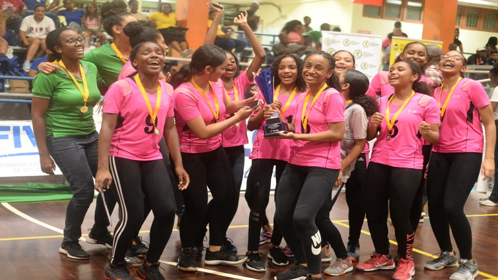 The victorious Suriname Girls' Under-18 volleyball team.