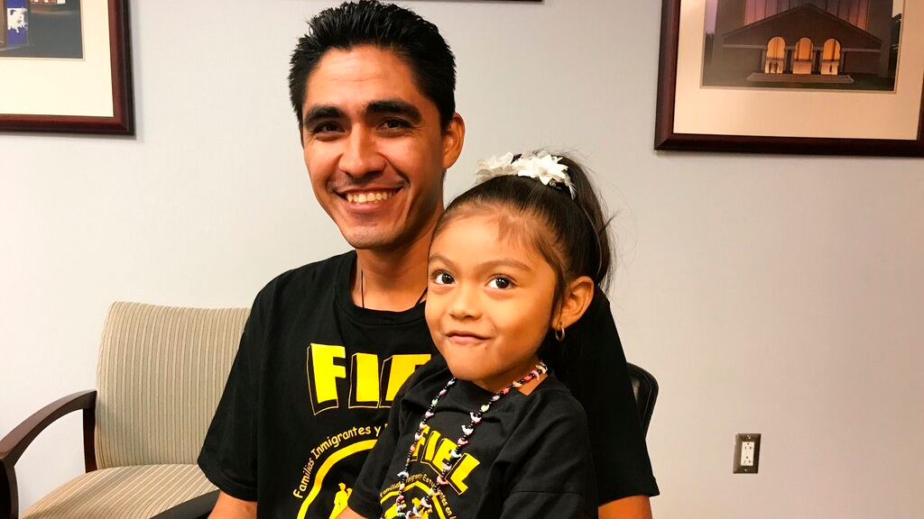 Jose Escobar poses with his daughter Carmen shortly after returning to the United States at Houston's George Bush Intercontinental Airport, Monday, July 1, 2019, two years after he was deported to El Salvador. (AP Photo/Nomaan Merchant)