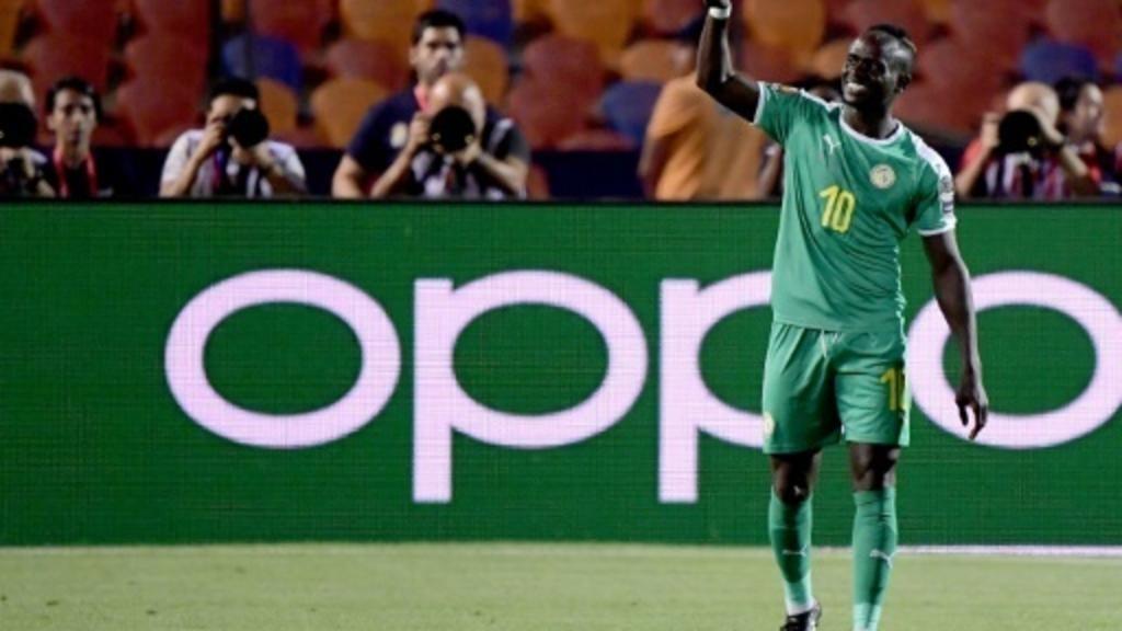 L'attaquant sénégalais Sadio Mané célèbre son but face à l'Ouganda en huitièmes de finale de la Coupe d'Afrique des Nations, le 5 juillet 2019 au Caire AFP