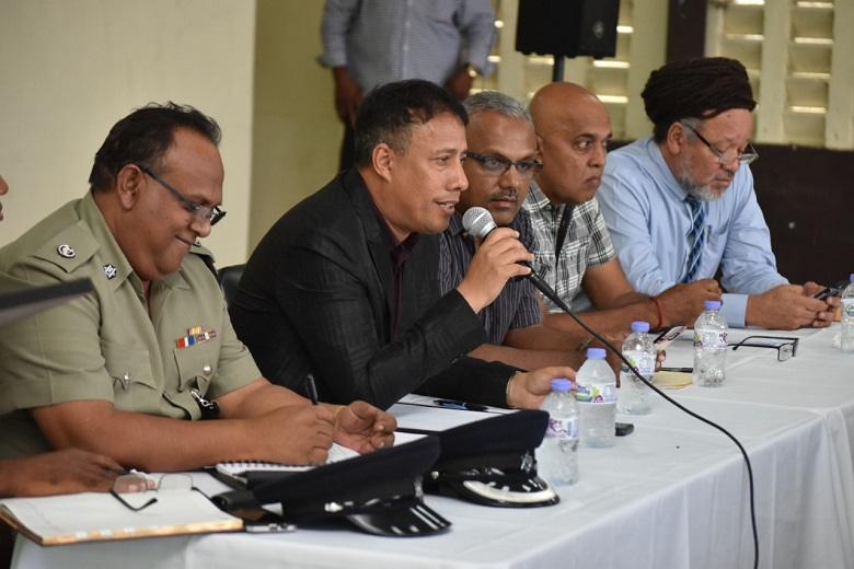Police Commissioner Gary Griffith sits alongside Couva South MP Rudranath Indarsingh.