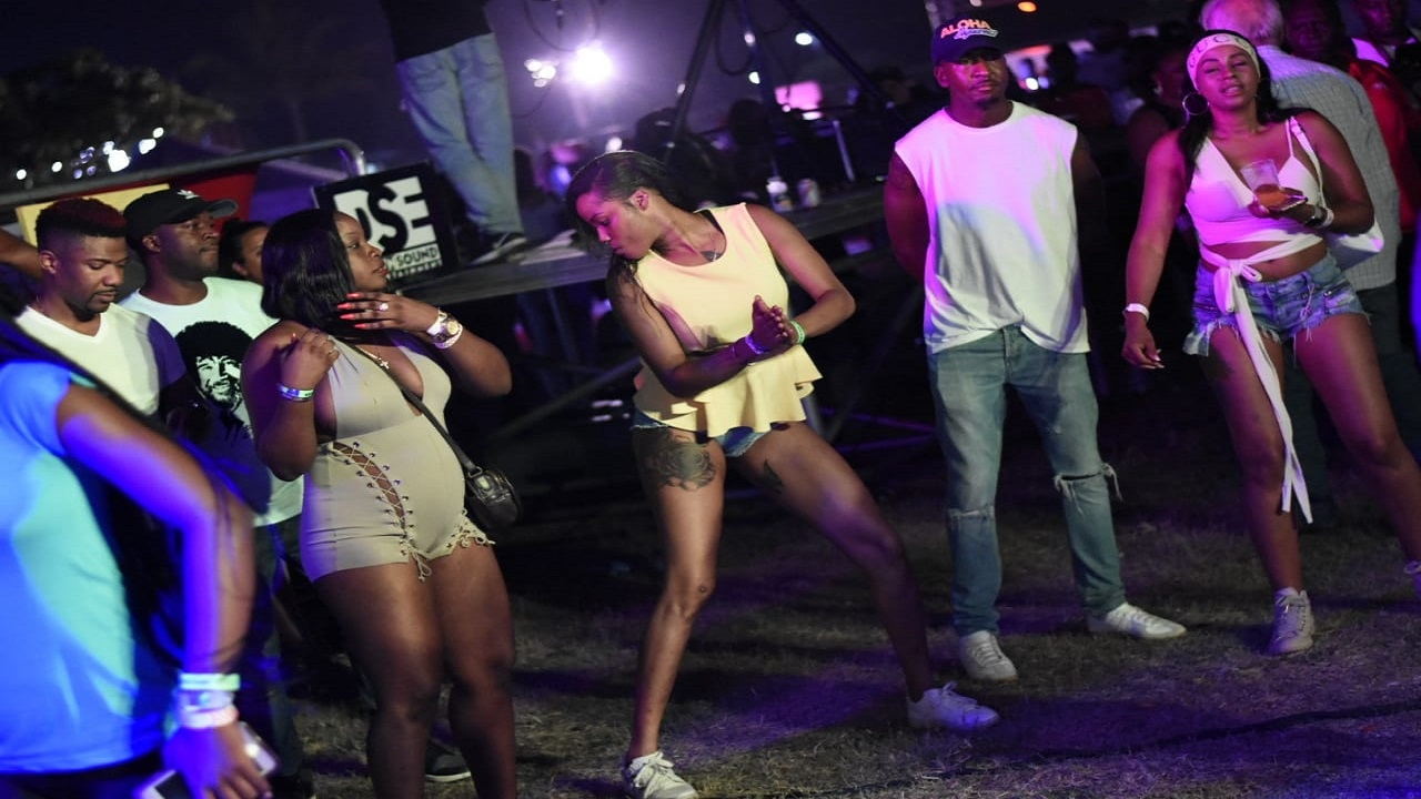 A patron (centre) catches the attention of our lens with her dance display during last year's Reggae Sumfest sound clash.  This year's staging of the event, part of the Sumfest festivities, will be held on Thursday.