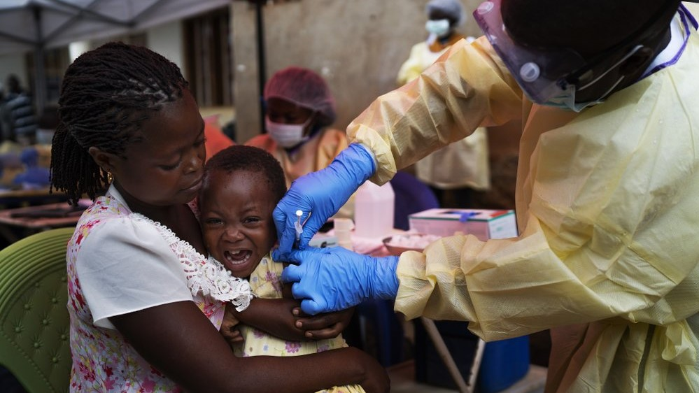 In this Saturday, July 13, 2019 photo, a child is vaccinated against Ebola in Beni, Congo. Health experts agree the experimental Ebola vaccine has saved multitudes in Congo. But after nearly a year and some 171,000 doses given, the epidemic shows few signs of waning. (AP Photo/Jerome Delay)