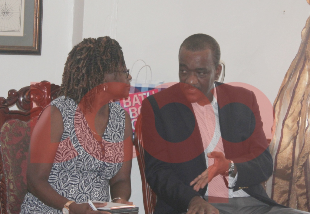 Minister Jeffrey Bostic in discussions with President of the Pharmacy Council, Marina Thompson.
