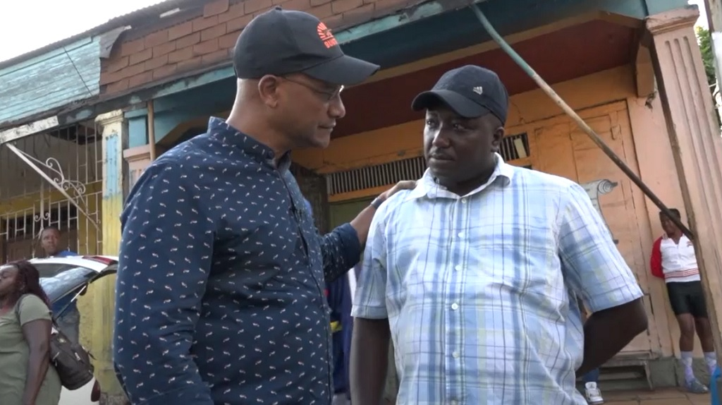 PNP presidential hopeful listens attentively to a resident during a recent tour of Clarendon.