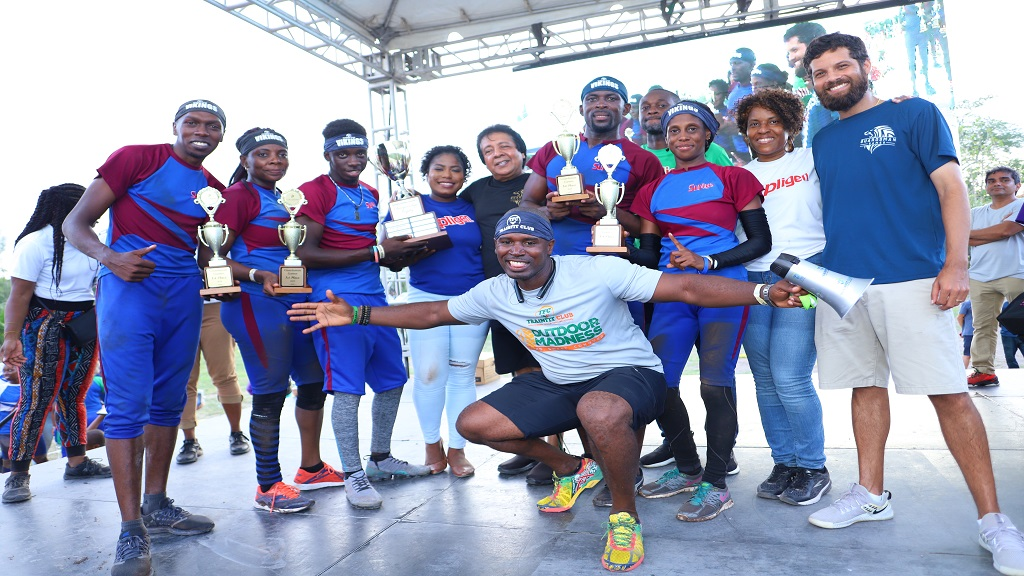 Guardsman Group Chairman Kenny Benjamin (fifth left) and Guardsman Group Director of Operations Nicholas Benjamin (right) share in the glee of Power Games Champions the Supligen Vikings at the prize-giving ceremony on Sunday, July 28, 2019.