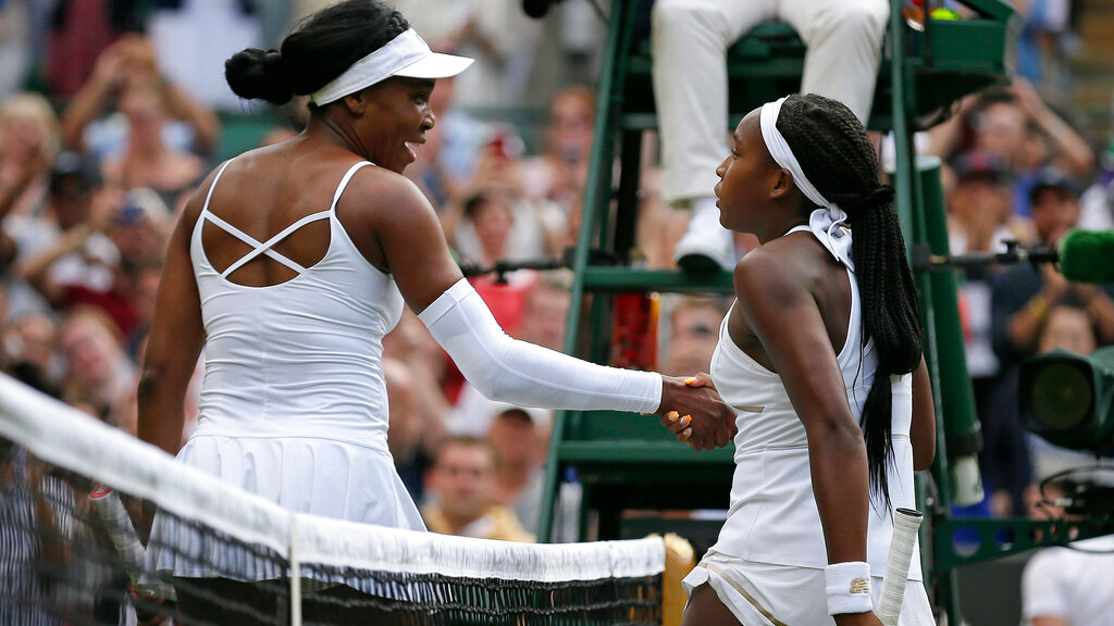 "United States' Cori ""Coco"" Gauff, right, greets the United States's Venus Williams at the net after winning their Women's singles match during day one of the Wimbledon Tennis Championships in London, Monday, July 1, 2019. (AP Photo/Tim Ireland)"