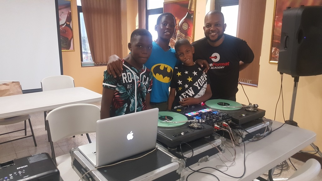DJ Denvo and winning team members (from left) Duhane Sampson Sanjay Loague and Roy Dallas.
