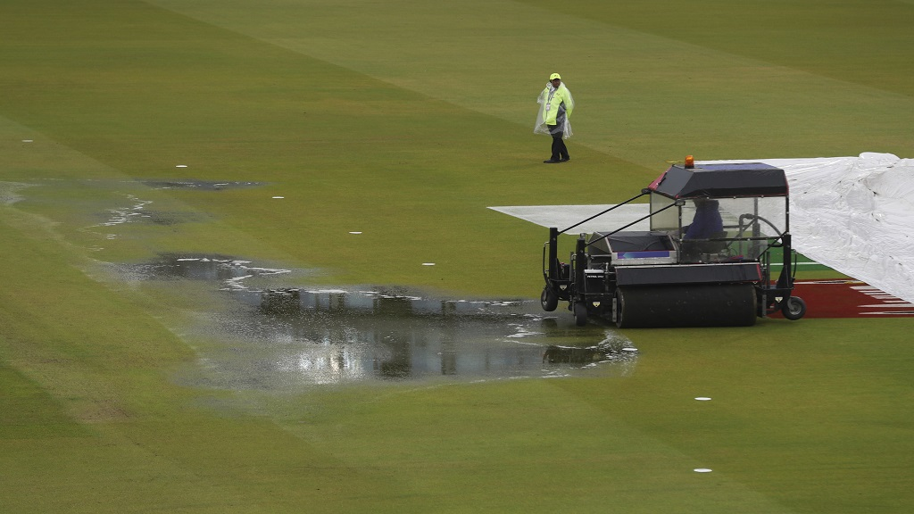 A super sopper is used to remove water after rain stopped play during the Cricket World Cup semi-final match between India and New Zealand at Old Trafford in Manchester, England, Tuesday, July 9, 2019. (AP Photo/Aijaz Rahi).