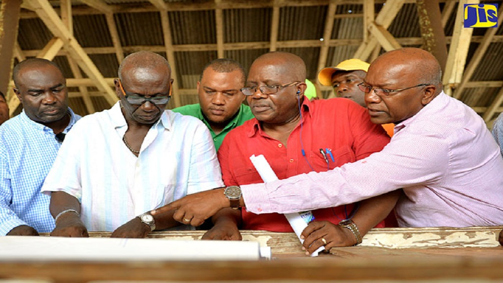 Local Government Minister, Desmond McKenzie (second left), being shown an aspect of the plans for the reconstruction of the Port Maria Market in Central St Mary by Member of Parliament (MP), Dr Morais Guy (right), during a tour of the facility on November 15, 2016. Others looking on include Superintendent of Roads and Works at the St Mary Municipal Corporation, Garfield Thompson (left); then former, but now current Port Maria Mayor, Richard Creary (3rd right); and then Mayor, Leevan Freeman (2nd right).