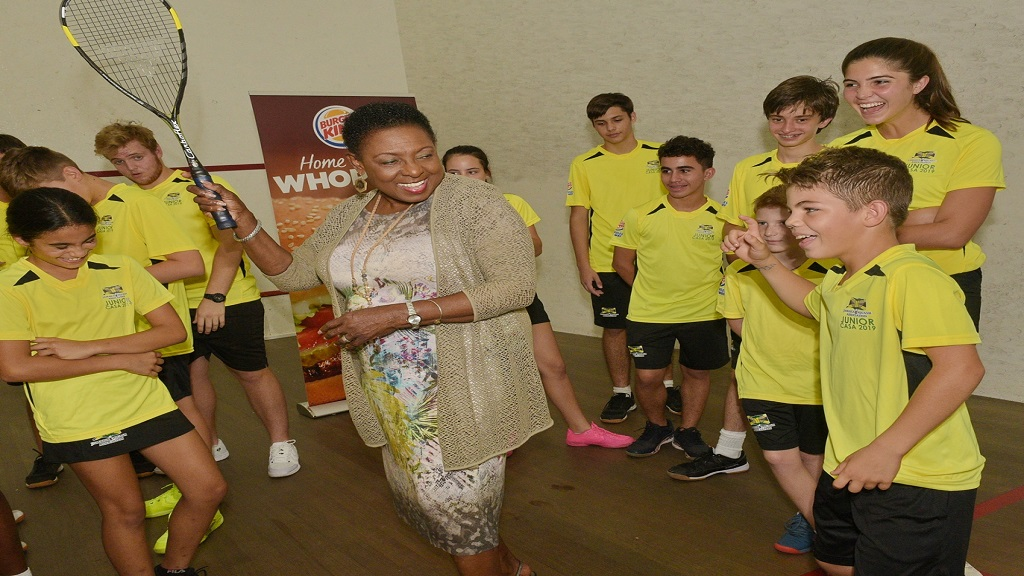 Sports Minister Olivia Grange (centre) poses members of Jamaica's junior national squash team at the Liguanea Club on Wednesday, July 10, 2019. The Minister met with the junior players who will represent Jamaica at the 2019 Caribbean Area Squash Association's (CASA) Junior Championships in Trinidad and Tobago.