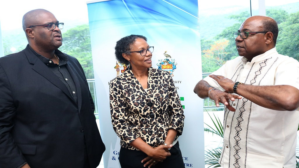 Professor Lloyd Waller (left), Executive Director, Global Tourism Resilience and Crisis Management Centre (GTRCM); Professor Mona Webber, Director, Centre for Marine Sciences and Discovery Bay Marine Laboratory; and Jamaica's Minister of Tourism and GTRCM Co-Chair, Edmund Bartlett (right) discuss the sargassum threat  during the GTRCM Roundtable on Sargassum at UWI Region Headquarters, Mona.
