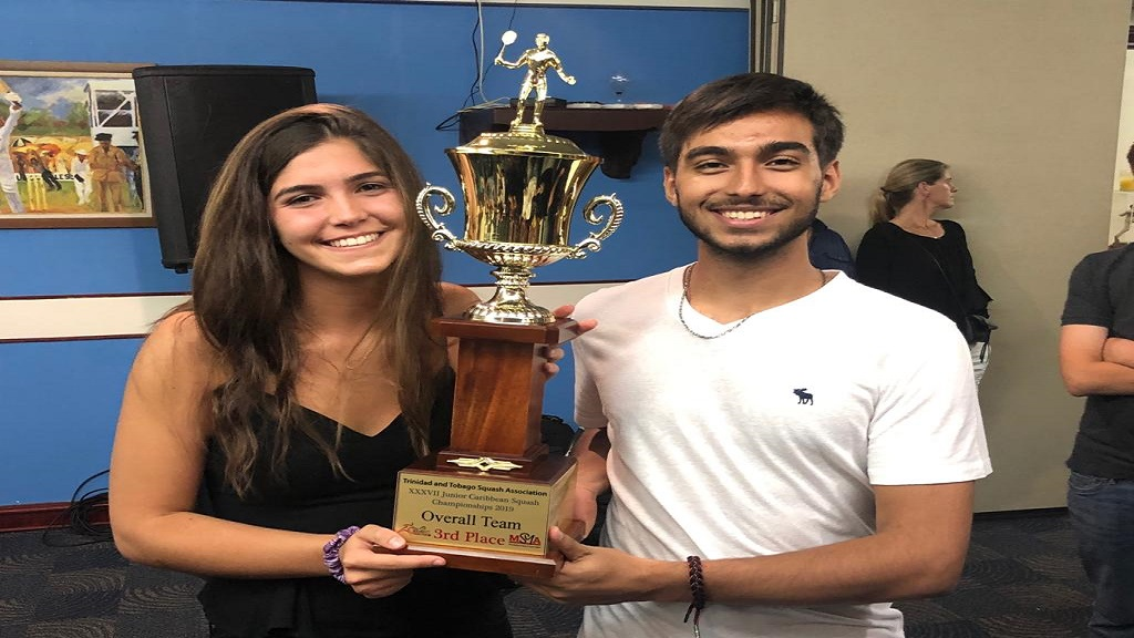 Co-captains of Jamaica's junior national squash team, Mia Mahfood (left) and Karan Dhiman display the team trophy that Jamaica received after placing third overall in the 2019 Caribbean Area Squash Association's (CASA) Junior Championships in Trinidad and Tobago.