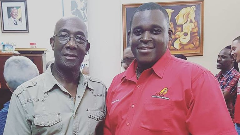 Ndale Young with Prime Minister Dr Keith Rowley
