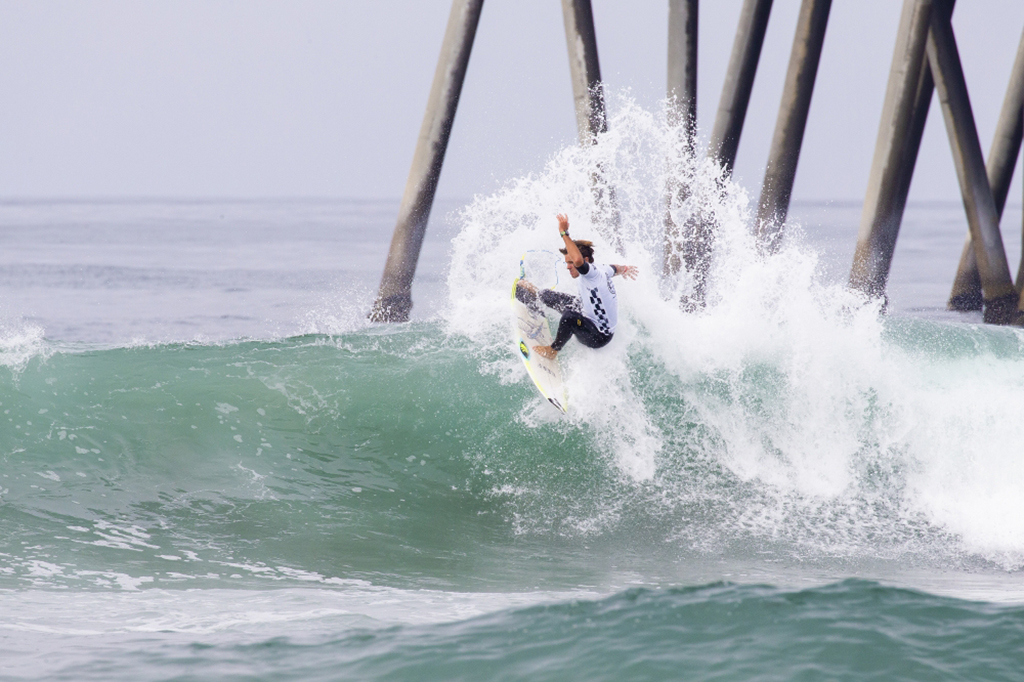 Josh Burke riding a wave at Huntington Beach (Photo Credit: Kenny Morris/WSL)
