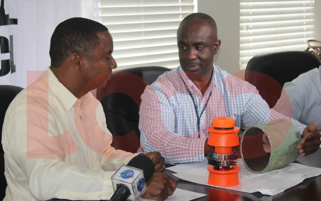 Minister Wilfred Abrahams (left) and Operations Superintendent, Terrence Straughn (right) discussing the inspection of pipelines.