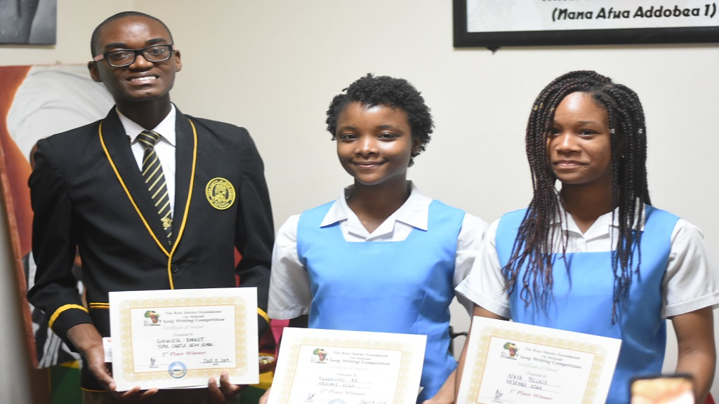 Afaya Pollack (right) won ahead of schoolmate Ruwenzori Ra (centre) who collected $25,000 and York Castle High School's Shawvick Barrett who got $15,000 for his effort.