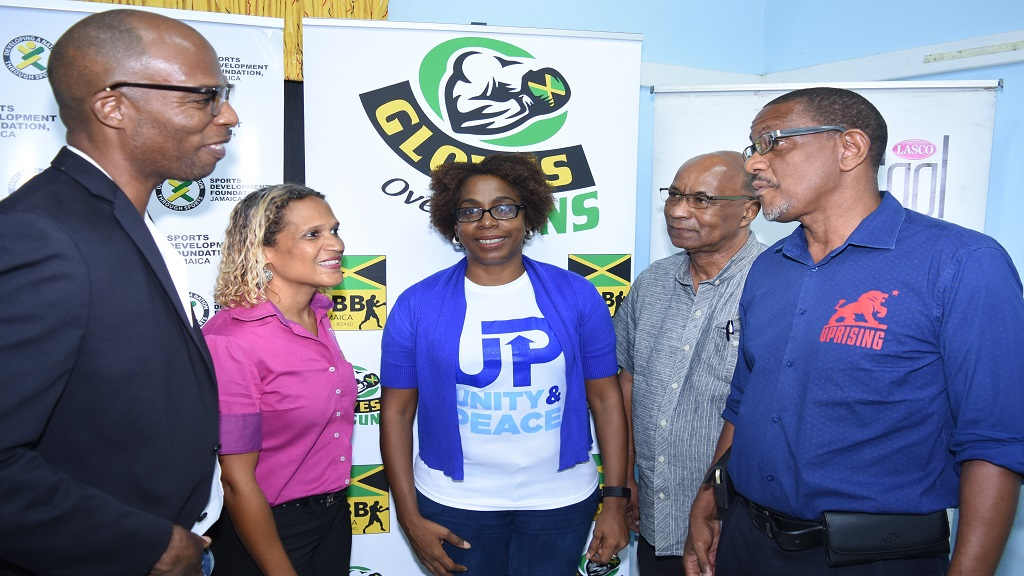 President of the Jamaica Boxing Board Stephen Jones (left) in discussion with Dannielle Cunningham, marketing manager at LASCO, Kelly Magnus of Fight For Peace; Trevor Spence of the Trench Town CDC and John Isaacs, fight promoter of Creative Sports. Occasion was the launch of a fight card, which took place on Wednesday, July 3 at the offices of the Sports Development Foundation.