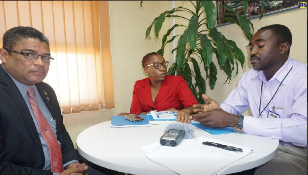 Managing Director of the Water Resources Authority (WRA), Peter Clarke (left); Senior Librarian and Acting Public Education Officer at the WRA, Roshelle Archer-James and Senior Hydrogeologist at the WRA, Kevin Chambers, take part in a recent interview.