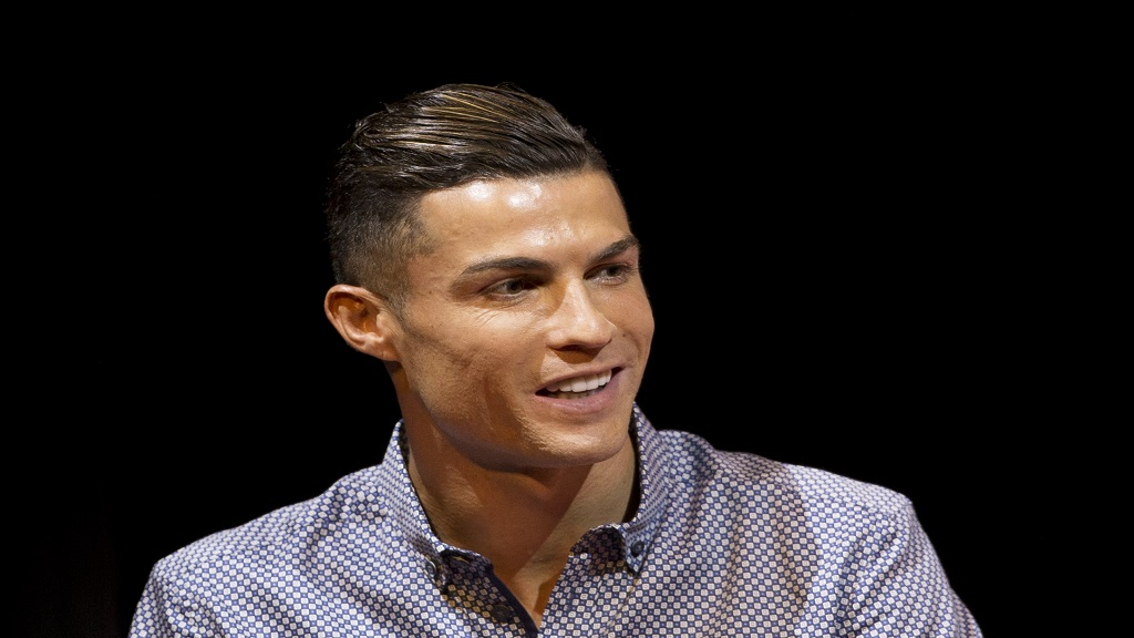 Juventus football player Cristiano Ronaldo speaks after receiving the Lifetime Achievement award given by the Spanish sports paper 'Marca', in Madrid, Spain, Monday, July 29, 2019.