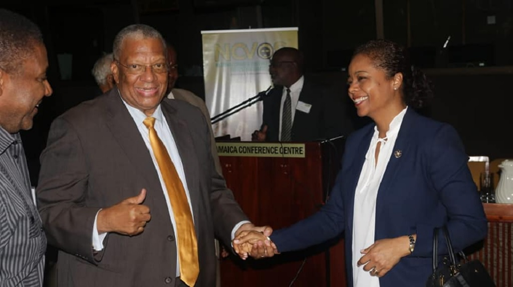 Opposition Leader Dr Peter Phillips (centre) shares a laugh with Attorney General Marlene Malahoo Forte and Opposition spokesperson on Energy, Phillip Paulwell at the PNP's crime summit at the Jamaica Conference Centre in downtown Kingston on Tuesday. (PHOTO: Contributed)