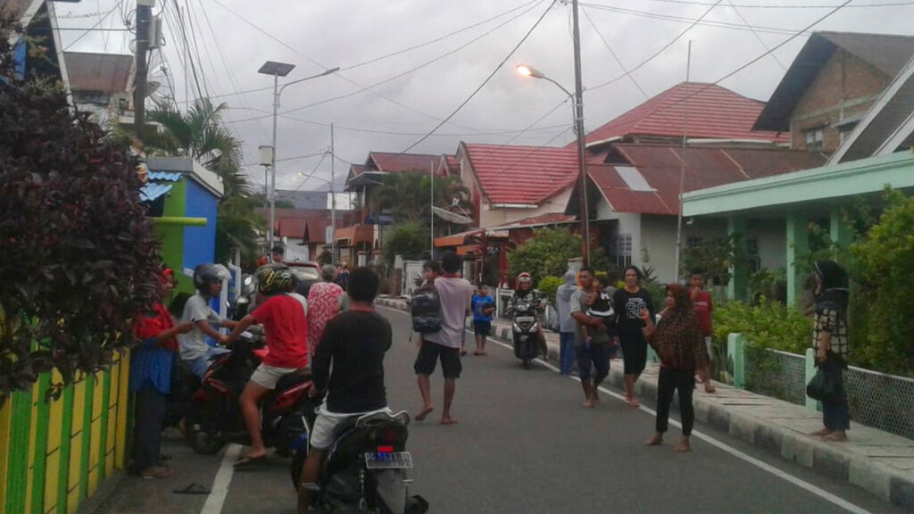 Residents leave their homes to find higher grounds following an earthquake in Ternate, North Maluku, Indonesia, Sunday, July 14, 2019. A strong, shallow earthquake struck eastern Indonesia on Sunday, damaging some homes and causing panicked residents to flee to temporary shelters. There were no immediate reports of casualties, and authorities said there was no threat of a tsunami. (AP Photo)