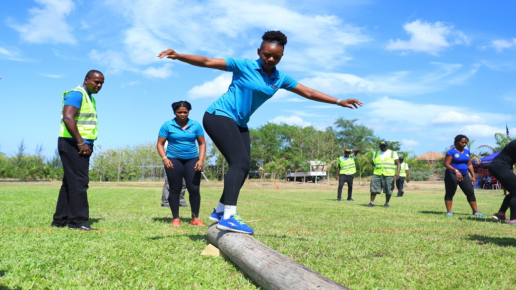 A member of the JN Bank Channels Gladiators negotiates the beam in the Giddy Challenge during the Guardsman Games Power Games eliminations on Saturday, June 29, 2019.