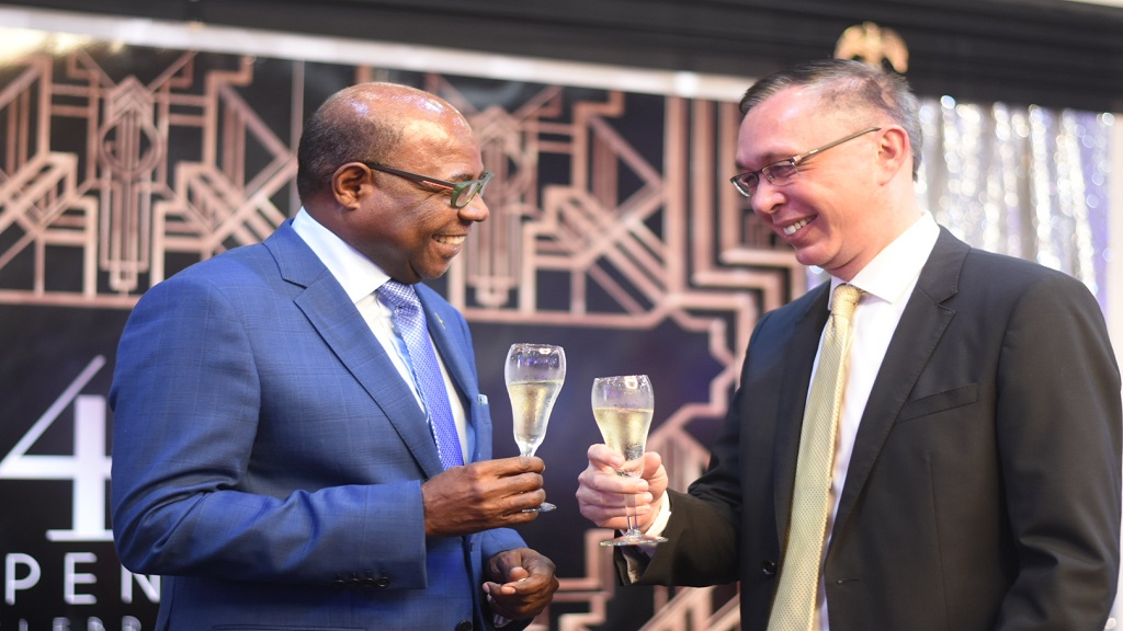 Chargé d'affaires for the United States of America Eric Khant (right) and Tourism Minister Edmund Bartlett at a reception  celebrating 243rd anniversary of the independence of the United States.