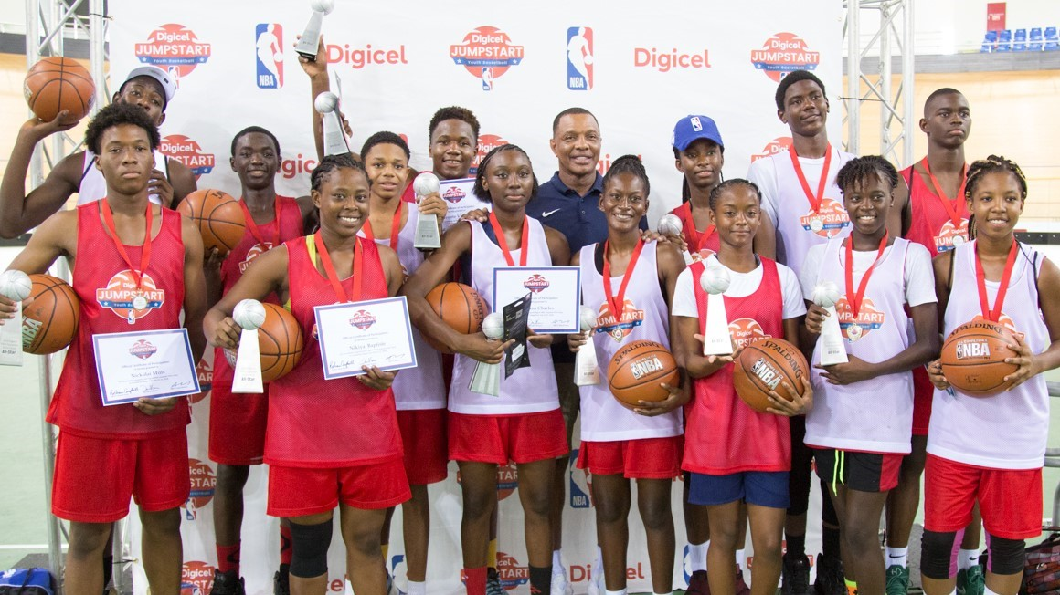 Photo 1- The 14 winners of the 2018 NBA Experience and Head Coach of the New Orleans Pelicans, Alvin Gentry are smiles after the Elite Camp in Trinidad & Tobago.