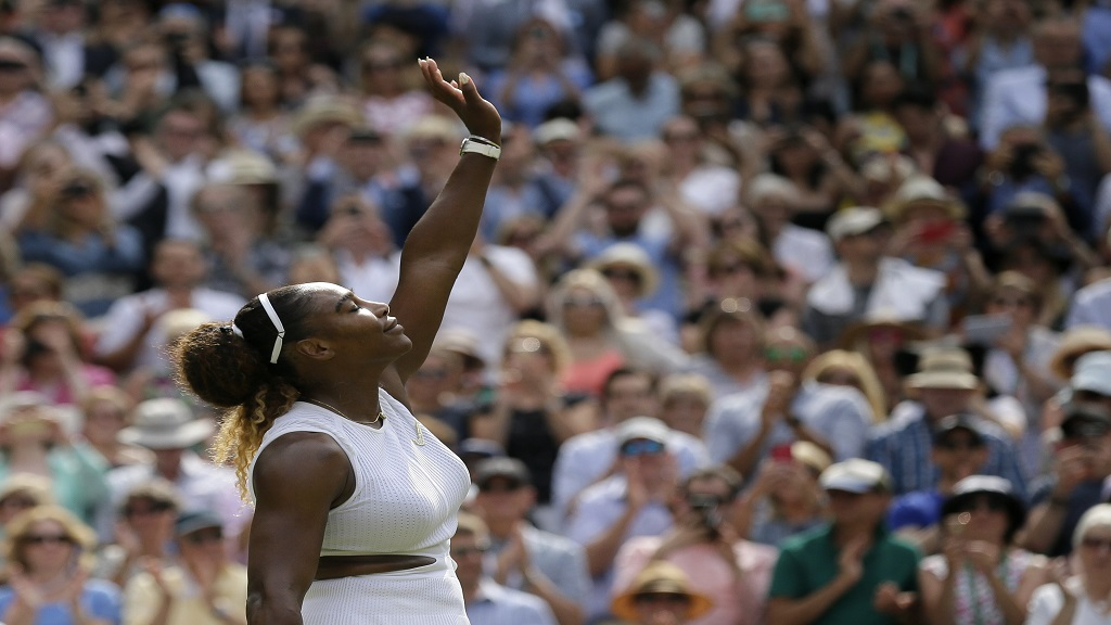 United States' Serena Williams celebrates defeating Czech Republic's Barbora Strycova during a women's singles semifinal match on day 10 of the Wimbledon Tennis Championships in London, Thursday, July 11, 2019.