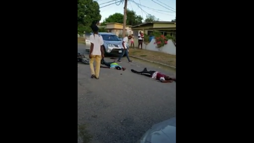 A screen grab from a video of the scene where two alleged gunmen were shot dead by police personnel in Zaidie Gardens, St Andrew on Saturday evening.