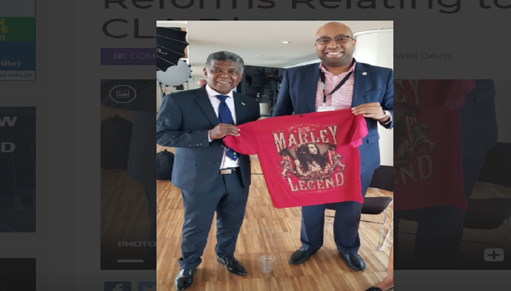 Deputy Prime Minister of the landlocked African nation of Lesotho, Hon. Monyane Moleleki (left), is presented with a Bob Marley T-shirt by Director, Cannabis Licensing Authority, Delano Seiveright, at the Cannabis Europa Conference at the Southbank Centre in London, United Kingdom, recently. Mr. Moleleki and Mr. Seiveright were among a range of speakers from across the globe. Lesotho is the first African country to legalise the cultivation and manufacturing of medicinal cannabis.