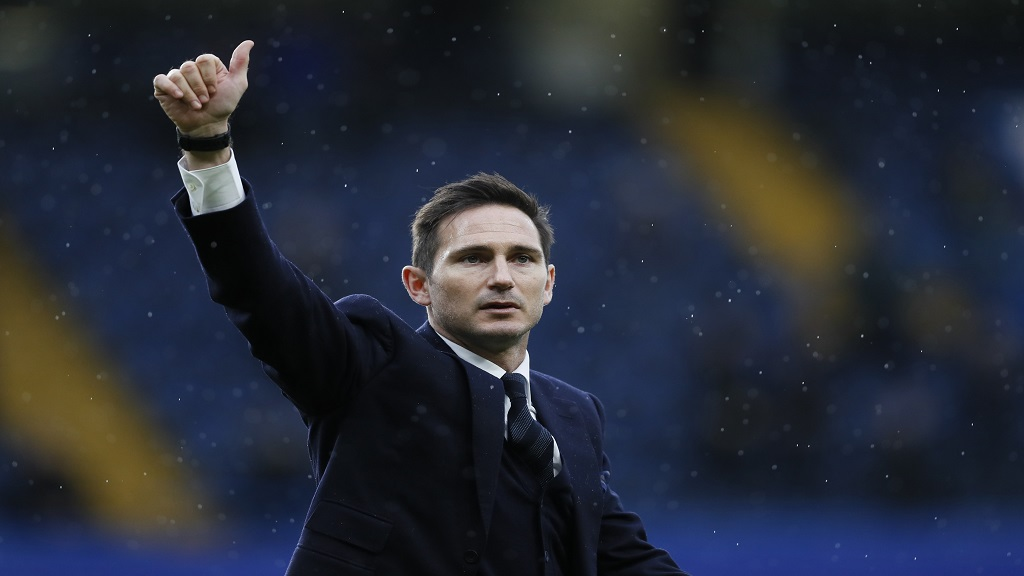 In this Saturday, Feb. 25, 2017 file photo, former Chelsea player Frank Lampard does a lap of honour at half time during the English Premier League soccer match between Chelsea and Swansea City at Stamford Bridge stadium in London. Lampard has returned to Chelsea as the club's 12th manager in 16 years under Roman Abramovich's ownership.