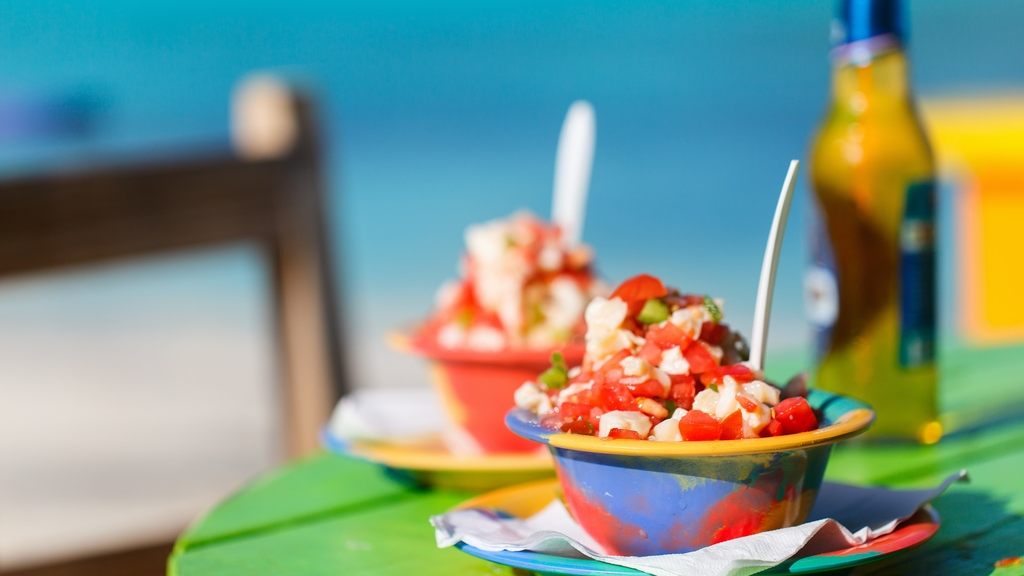 Two Bahamian conch salads on a green table. GettyImages