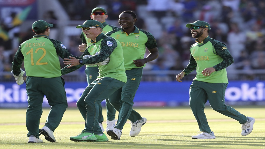 South Africa players celebrate after Australia's Glenn Maxwell, left, is bowled by Kagiso Rabada, 2nd right, caught Quinton de Kock, left, during their Cricket World Cup match at Old Trafford in Manchester, Saturday, July 6, 2019. (AP Photo/Rui Vieira)