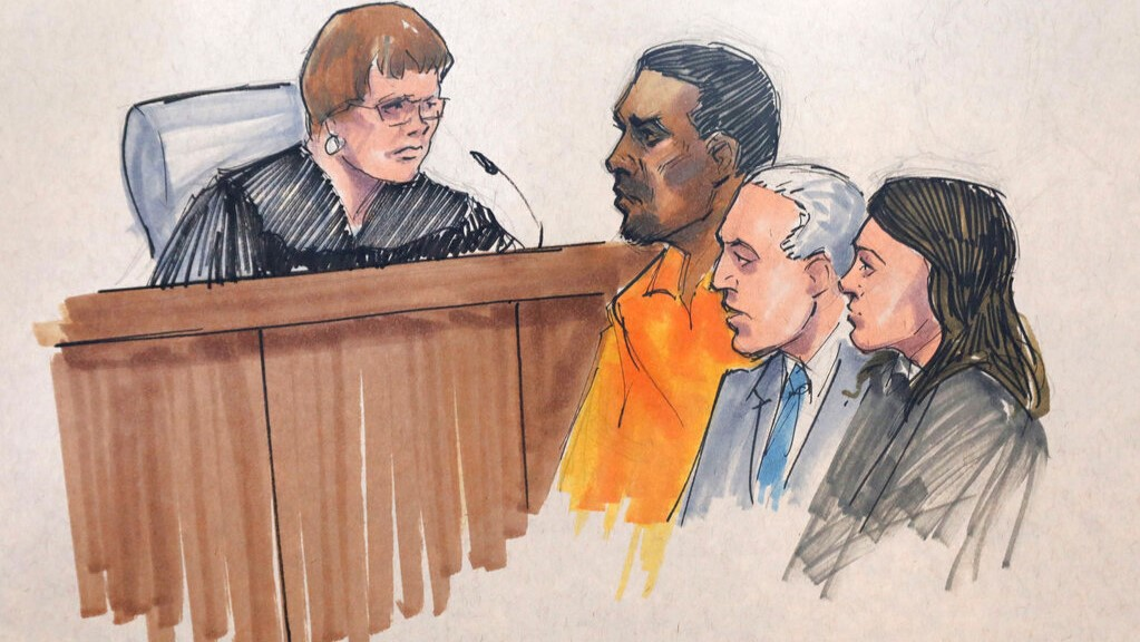 In this courtroom sketch, R&B singer R. Kelly, centre, appears before U.S. Magistrate Shelia M. Finnegan, left, in U.S. District Court for the Northern District of Illinois. (AP Photo/Tom Gianni via AP)