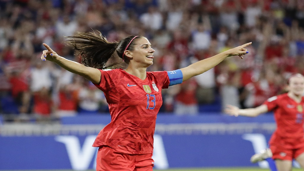 United States' Alex Morgan celebrates after scoring her side's second goal during the Women's World Cup semifinal football match against England at the Stade de Lyon, outside Lyon, France, Tuesday, July 2, 2019.