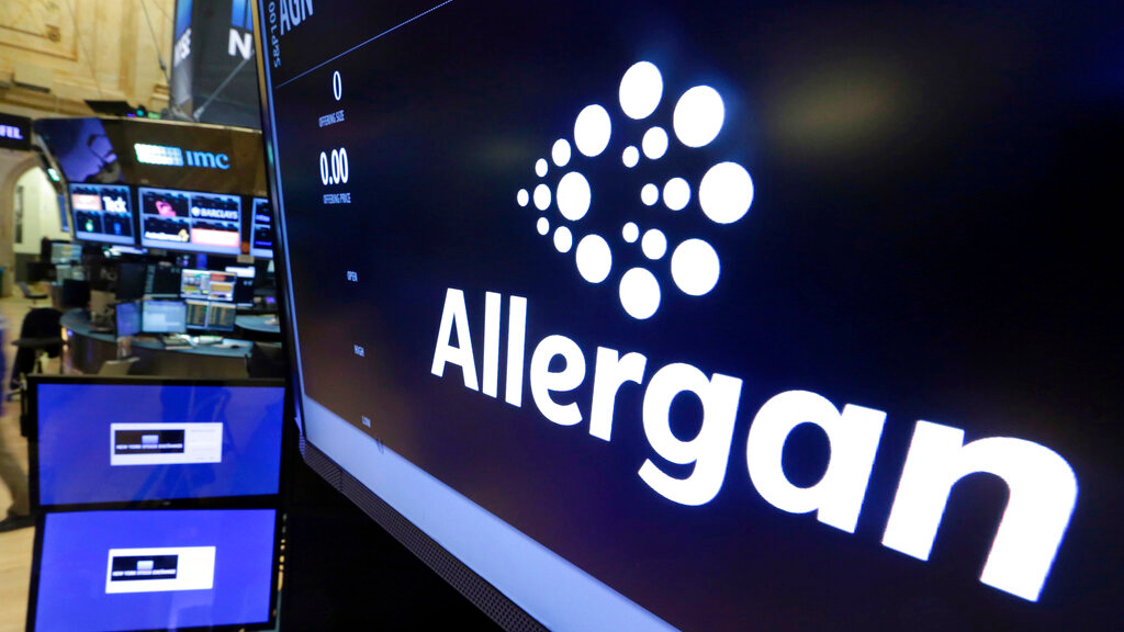 FILE - In this Monday, Nov. 23, 2015, file photo, the Allergan logo appears above a trading post on the floor of the New York Stock Exchange. (AP Photo/Richard Drew, File)