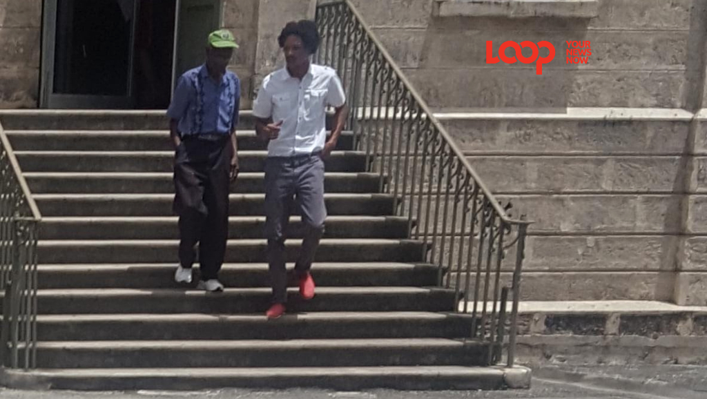 Dwayne Marshall (white shirt) leaving District A Magistrate's Court. He was released on $20 000 bail.