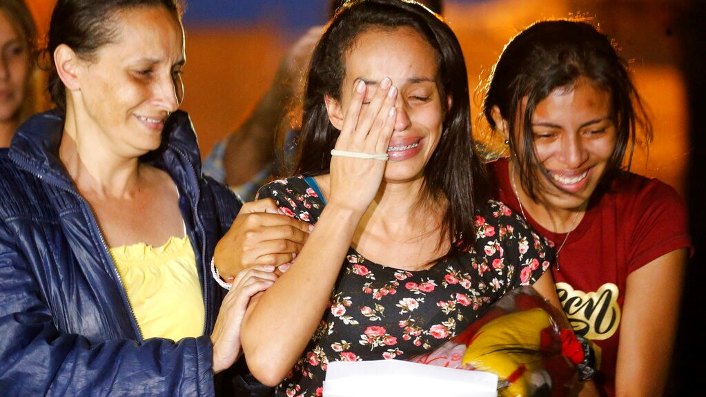 Karen Palacios, centre, is helped by family members after she was released from prison at Los Teques on the outskirts of Caracas, Venezuela, Tuesday, July 16, 2019.  (AP Photo/Ariana Cubillos)