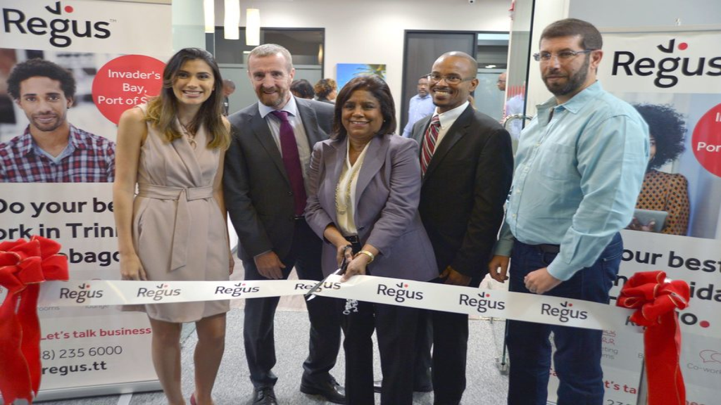 Officially open for Business! L- R: Stephanie Quesnel, Regus General Manager; Mark Linehan, Managing Director Regus Caribbean; Paula Gopee-Scoon Minister of Trade and Industry; Andre Walcott, CEO Williams Industries and Dominic Hadeed, Chairman of DomHad Properties Limited are all smiles as they formally open the new Regus centre. Photo via Regus.