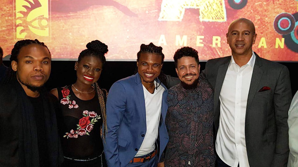 "(L-R) Sprinter Cast Members Kadeem Wilson, Shantol Jackson, and Dale Elliot; Filmmaker, Storm Saulter, and CEO of Hyperion Equity, Zachary Harding, pose for a picture at the American Black Film Festival, where the project won ""Best Director"", ""Best Narrative Feature"" and the ""Audience Award""."