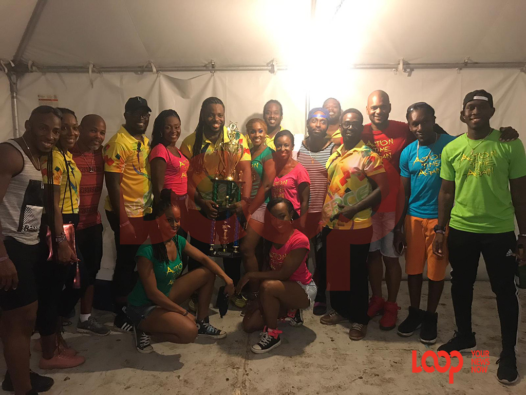 Surrounded by Team Mikey: the 2019 Soca Monarch Michael Mikey Mercer (holding trophy) is all smiles after tonight's victory.