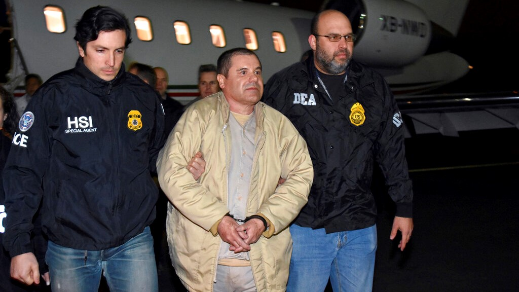 "In this Jan. 19, 2017, file photo provided by U.S. law enforcement, authorities escort Joaquin ""El Chapo"" Guzman, centre, from a plane to a waiting caravan of SUVs at Long Island MacArthur Airport, in Ronkonkoma, N.Y. (U.S. law enforcement via AP, File)"