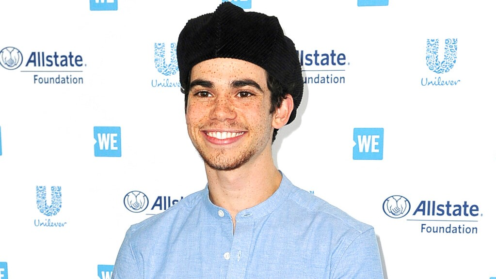 This April 25, 2019 file photo shows actor Cameron Boyce at WE Day California in Inglewood, Calif. Los Angeles coroners officials said Tuesday, July 30, 2019, that Boyce died unexpectedly from epilepsy. He was pronounced dead at his home on July 6. (Photo by Richard Shotwell/Invision/AP, File)