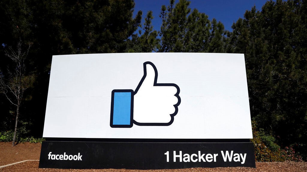 This March 28, 2018, file photo shows a Facebook logo at the company's headquarters in Menlo Park, Calif.  (AP Photo/Marcio Jose Sanchez, File)