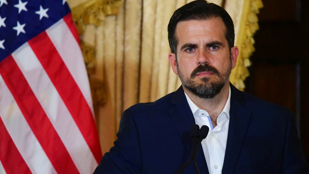 Puerto Rico governor Ricardo Rossello holds a press conference, almost two days after federal authorities arrested the island's former secretary of education and five other people on charges of steering federal money to unqualified, politically connected contractors, in San Juan, Puerto Rico, Thursday, July 11, 2019. (AP Photo/Carlos Giusti)